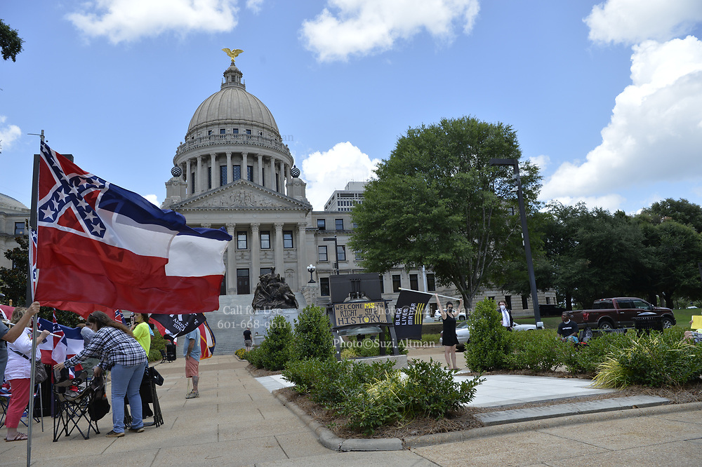 6/28/2020 Jackson MS. <br /> The Mississippi State legislators gathered at the State Capitol Sunday for a historic vote on HB1796. The MS House of Representatives  passed the Bill91-23 and the MS Senate voted 31-14 in favor of changing the flag. The Bill would allow for the redesign of the Mississippi State Flag, the current flag has the Confederate symbol on it. Mississippi is the last State in the Nation to still have the racist Confederate symbol on its state flag. Black Lives Matter advocates celebrated the historic vote outside the Capitol. The Mississippi House of Representatives passed the Bill and so did the Mississippi Senate, Governor Tate Reeves said he would sign it if it passed. Photo © Suzi Altman