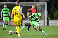 Forest Green Rovers Reece Brown(10) and Oxford United's Rob Dickie(4) challenge for the ball during the The FA Cup 1st round replay match between Forest Green Rovers and Oxford United at the New Lawn, Forest Green, United Kingdom on 20 November 2018.