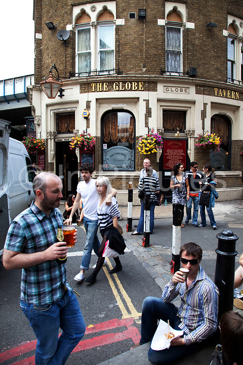 Drinkers outside the famous Globe Tavern. Made famout in the second Briget Jones movie. Borough Market is a thriving Farmers market near London Bridge. Saturday is the busiest day.