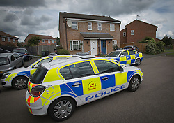 © London News Pictures. 10/06/2012.  Ampthill, UK. Police cars outside  the property in Amphill, Bedfordshire, where 15-year-old Megan-Leigh Peat died in the early hours of Saturday morning. It is believed that Schoolgirl Megan-Leigh Peat was stabbed to death at a house party thrown by a boy whose parents are away on holiday. Photo credit: Ben Cawthra/LNP