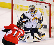 Ottawa Senators' Daniel Alfredsson, of Sweden, scores on Buffalo Sabres' Jocelyn Thibault during second period  NHL hockey action at the Scotiabank Place in Ottawa on Thursday Jan. 10, 2008. .THE CANADIAN PRESS/Sean Kilpatrick..
