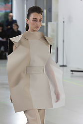 © Licensed to London News Pictures. 03/06/2015. London, UK. Collection by Zhujing Jiang. A model walks the runway at the Royal College of Art (RCA) MA Fashion graduate fashion show.  Photo credit : Bettina Strenske/LNP
