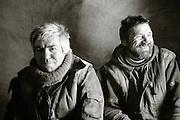 Portait of fisherman in thier canvas hut on the frozen Lake Baikal, Siberia, Russia