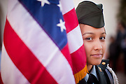14 JANUARY 2012 - CHANDLER, AZ:    A member of the Color Guard from Cesar Chavez High School JROTC unit holds the American flag before a naturalization ceremony in Chandler, AZ, Jan. 14. More than 140 people from 21 countries were naturalized as United States citizens Saturday in Chandler. This is the third year Chandler has sponsored a naturalization ceremony in connection with the Dr. Martin Luther King holiday.  PHOTO BY JACK KURTZ