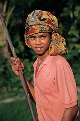 Asia, Indonesia, Sulawesi, Tana Toraja region. Boy wearing colorful scarf