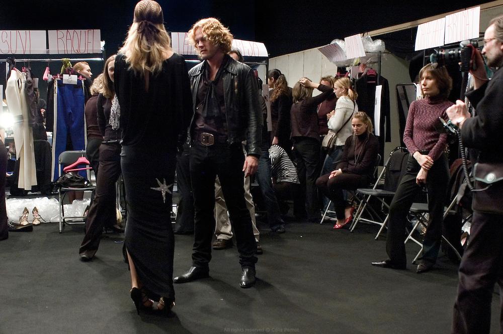 designer Peter Dundas getting models ready backstage before Ungaro fashion show