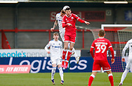 Leeds United defender Liam Cooper (6) wins the header during the The FA Cup match between Crawley Town and Leeds United at The People's Pension Stadium, Crawley, England on 10 January 2021.