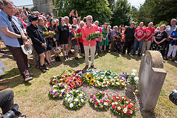 © Licensed to London News Pictures. 21/07/2019; Tolpuddle, Dorset, UK. JEREMY CORBYN, leader of the Labour Party, with ANGELA RAYNER MP, attends the wreath laying at the grave of Tolpuddle Martyr James Hammett at the church in the village of Tolpuddle, part of the Tolpuddle Martyrs Festival. The Tolpuddle Martyrs Festival for trade unionism, held every year, commemorates the birth of the trade union movement in the 19th century when the Tolpuddle Martyrs were transported to Australia for forming a trade union of agricultural labourers in Dorset. Photo credit: Simon Chapman/LNP.