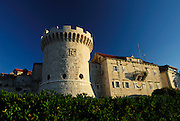 Kula Kanavelic (aka Tower Bokar or Tower Barbarigo) and medieval houses in late afternoon sunlight. Korcula old town, island of Korcula, Croatia
