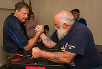 Governor Chris Sununu gets a quick lesson in arm wrestling from Ronnie Bean during the Arm Wrestling Tournament to benefit the Fallen 7 at the VFW in Laconia Saturday.  (Karen Bobotas/for the Laconia Daily Sun)