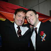 Partners Kevin Foster and Joey Thibodeaux wait in line outdoors for Osceola County Clerk Armando Ramirez to hand out marriage licenses and officiate same sex wedding ceremonies at 12:01 a.m., when Florida's ban on same-sex marriage ends, at the Osceola County Courthouse in Kissimmee, Florida on Tuesday, January 6, 2014.  (AP Photo/Alex Menendez)