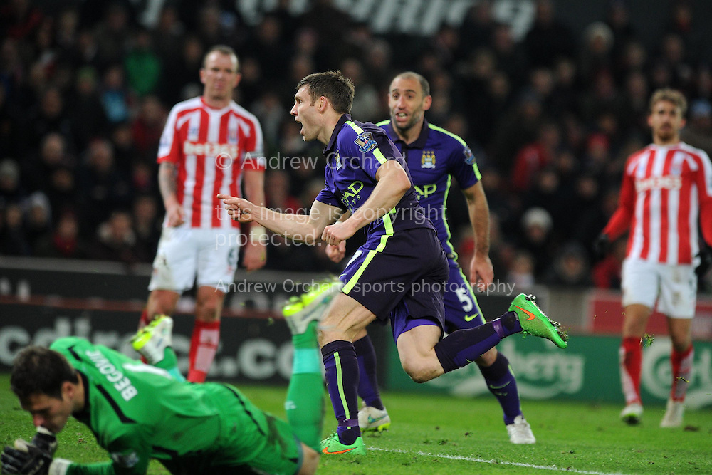 James Milner of Man city celebrates  after he scores his teams 2nd  goal to make it 1-2. . Barclays Premier League match, Stoke city v Manchester city at the Britannia Stadium in Stoke on Trent , Staffs on Wed 11th Feb 2015.<br /> pic by Andrew Orchard, Andrew Orchard sports photography.