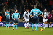 Swansea city capt Leon Britton (l) looks on dejected as they prepare to restart after conceding a goal.Premier league match, West Bromwich Albion v Swansea city at the Hawthorns stadium in West Bromwich, Midlands on Wednesday 14th December 2016. pic by Andrew Orchard, Andrew Orchard sports photography.