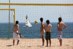 Locals playing football on Rocha Beach as crews train for Portimao Portugal Match Cup 2010. World match Racing Tour. Portimao, Portugal. 22 June 2010. Photo: Gareth Cooke/Subzero Images