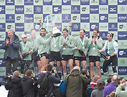 London,  England, Great Britain, 7th April CUBC Celebrate winning the 2019, Oxford and Cambridge Universities Men's Varsity, Boat Race, Championship Course, Putney to Mortlake, River Thames,<br /> [Mandatory Credit: Karon PHILLIPS], Sunday  07/04/2019: Crew: Dave BELL, <br /> James CRACKNELL, <br /> Grant BITLER, <br /> Dara ALIZADEH, <br /> Cullum SULLIVAN, <br /> Sam HOOKWAY, <br /> Freddie DAVIDSON, <br /> Natan WEGRZYCHI-SZYMCZYK, <br /> Cox, Matthew HOLLAND