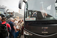 Tallinn, Estonia - July 31, 2015: Passengers traveling to Riga, Latvia, board a Lux Express bus at the bus station in Tallinn, Estonia.