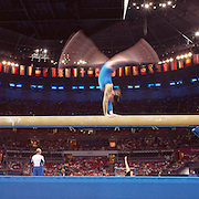 A panoramic image showing a female gymnast in action on the beam during the Women's Gymnastics competition at Sydney Olympic Park during the  2000 Sydney Olympic Games...Panoramic images from the Sydney Olympic Games, Sydney, Australia.  2000 . Photo Tim Clayton