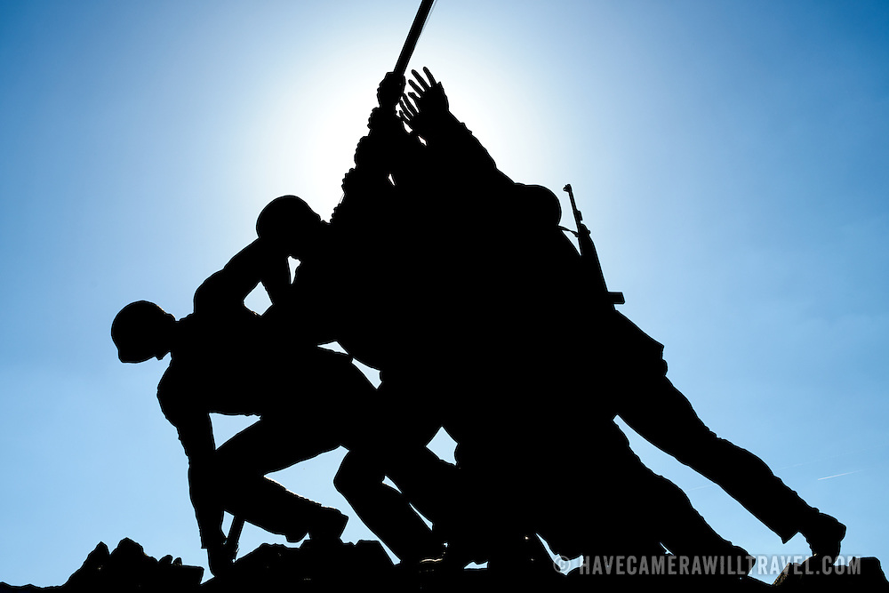 Silhouette of the main statue of the Iwo Jima Memorial (formally the Marine Corps War Memorial) in Arlington, Virginia, next to Arlington National Cemetery. The monument was designed by Felix de Wledon and is based on an iconic Associated Press photo called the Raising the Flag on Iwo Jima by Joe Rosenthal. It was dedicated in 1954.