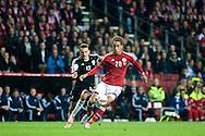 04.09.2015. Copenhagen, Denmark. <br /> Yussuf Poulsen (R) of Denmark fights for the ball with Kukeli (L) of Albania during their UEFA European Champions qualifying round match at the Parken Stadium. <br /> Photo: © Ricardo Ramirez.