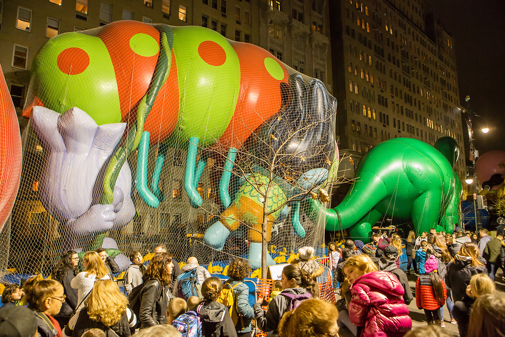 New York, NY – 27 November 2019. Thousands of spectators packed the streets around the American Museum of Natural History to see the inflation area for the balloons for Macy's Thanksgiving Day Parade. Spectators near the Trolls.