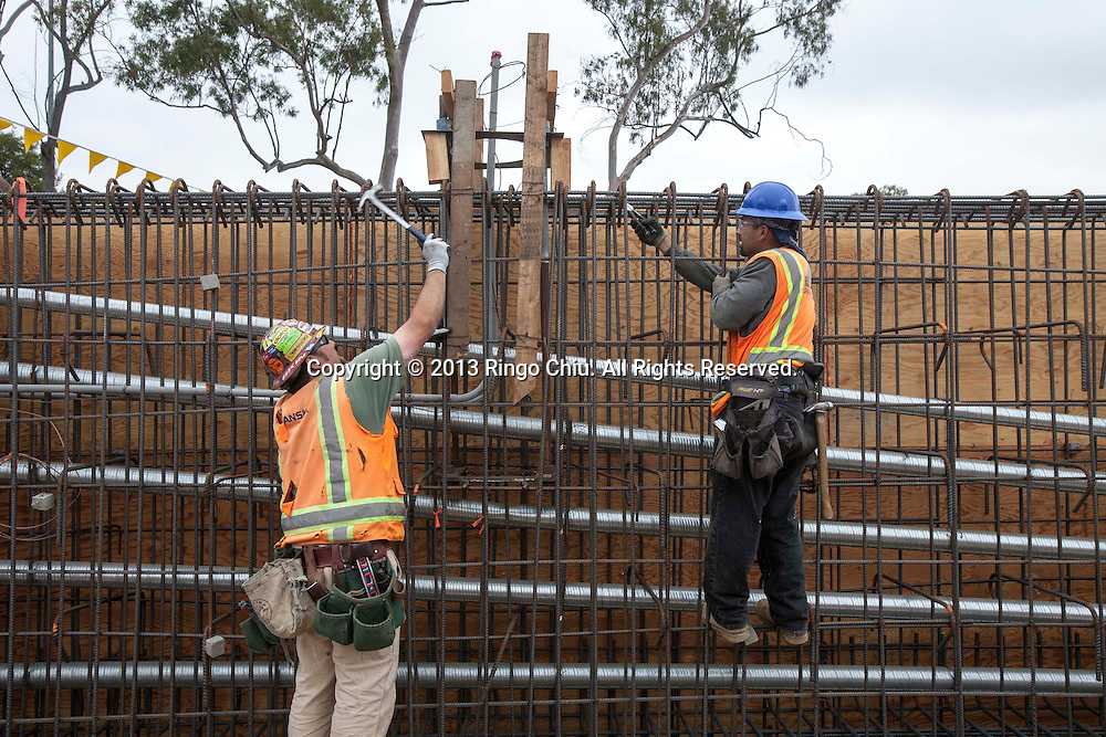 Workers tie the iron rods at the site of the construction of the Metro Expo Line extension at National and Palms boulevards in Los Angeles.  (Photo by Ringo Chiu/PHOTOFORMULA.com).