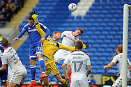 Cardiff City's Anthony Pilkington (13) beats Wigan goalkeeper Adam Bogdan (yellow shirt) to the cross but heads wide of goal. EFL Skybet championship match, Cardiff city v Wigan Athletic at the Cardiff city stadium in Cardiff, South Wales on Saturday 29th October 2016.<br /> pic by Carl Robertson, Andrew Orchard sports photography.
