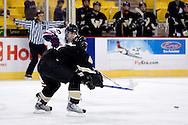 October 13, 2007 - Anchorage, Alaska: Sean Berkstresser (22) of the Robert Morris Colonials makes a pass past Ryan Bernardi (4) of the Wayne State Warriors in the Colonials 4-1 victory over the Warriors at the Nye Frontier Classic at the Sullivan Arena.