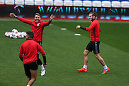 Gareth Bale of Wales ® jokes with Chris Gunter (l) during Wales football team training at the Cardiff city Stadium in Cardiff , South Wales on Saturday 8th October 2016, the team are preparing for their FIFA World Cup qualifier home to Georgia tomorrow. pic by Andrew Orchard, Andrew Orchard sports photography