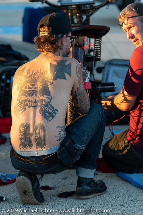 Team Vino mechanics Chrys Miranda of Brazil and Big Swede (you guessed it, of Sweden) work on Dean Bordigioni's 's bike. Motorcycle Cannonball coast to coast vintage run. Stage 5 (229 miles) from Bowling Green, OH to Bourbonnais, IL. Wednesday September 12, 2018. Photography ©2018 Michael Lichter.