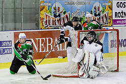 Gregor Rezek of HK Olimpija vs Ryan Klingensmith of HK Partizan during ice-hockey match between HK Olimpija and HK Partizan at second game in Final round of SLOHOKEJ league, on Februar 18, 2012 at Hala Tivoli, Ljubljana, Slovenia. (Photo By Matic Klansek Velej / Sportida)