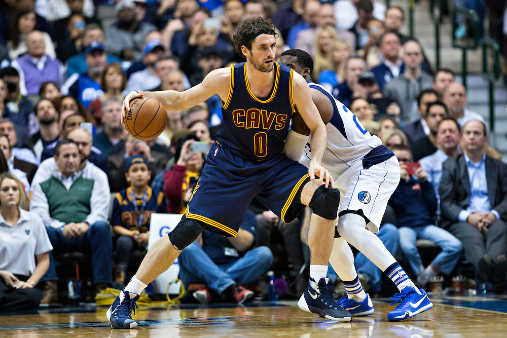 DALLAS, TX - JANUARY 12:  Kevin Love #0 of the Cleveland Cavaliers backs his way to the basket against Wesley Matthews #23 of the Dallas Mavericks at American Airlines Center on January 12, 2016 in Dallas, Texas.  NOTE TO USER: User expressly acknowledges and agrees that, by downloading and or using this photograph, User is consenting to the terms and conditions of the Getty Images License Agreement.  The Cavaliers defeated the Mavericks 110-107.  (Photo by Wesley Hitt/Getty Images) *** Local Caption *** Kevin Love; Wesley Matthews
