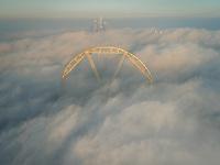Aerial view of the Ferris wheel in the clouds of Dubai, U.A.E.