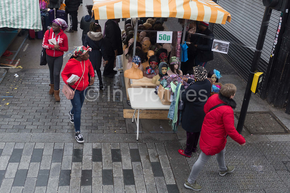A market stall selling womens headwear at East Street Market on the Walworth Road, Southwark, on 9th April 2019, in London, England.