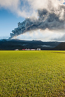 Farm Þorvaldseyri beneath the ash plume from Volcano Eyjafjallajökull, South Iceland. Early morning sun just breaking through the ash.