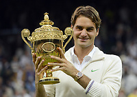 Wimbledon week 2 : Tennis Championships 07/07/2012 Credit Colorsport / Andrew Cowie<br /> Mens singles final Roger Federer v Andy Murray.<br /> Roger Federer with the trophy