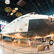 The Space Shuttle Discovery on display at the Smithsonian National Air and Space Museum's Udvar-Hazy Center. Located near Dulles Airport, the Udvar-Hazy Center is the second public facility of the Smithsonian's National Air and Space Museum. Housed in a large hangar are a multitude of planes, helicopter, rockets, and space vehicles.