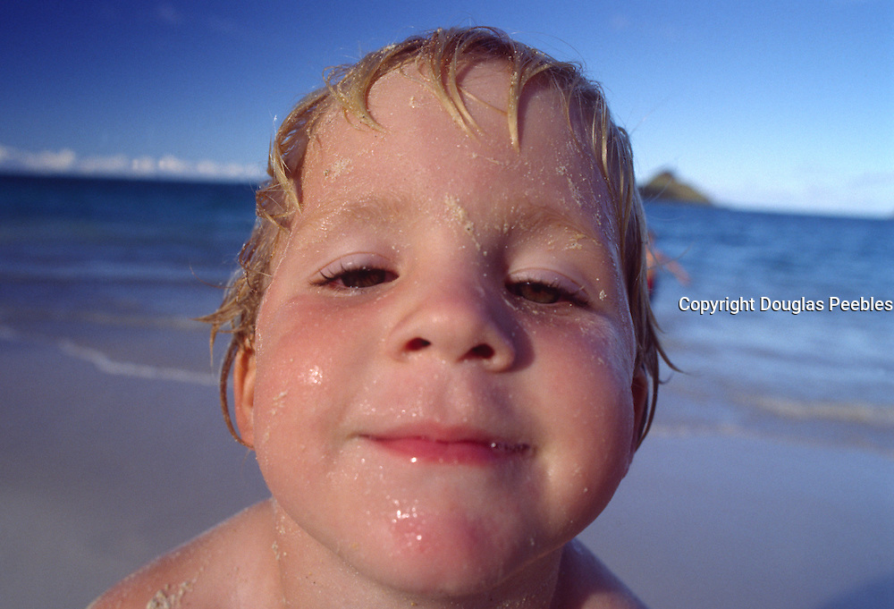 Boy on beach, Lanikai, Oahu, Hawaii<br />