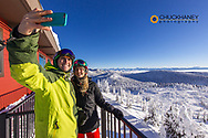 Couple takes selfie at Summit House at Whitefish Mountain Resort in Whitefish, Montana, USA model released