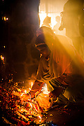 """2nd April 2015, New Delhi, India. Believers light candles and incense sticks at a shrine dedicated to Djinn worship in the ruins of Feroz Shah Kotla in New Delhi, India on the 2nd April 2015<br /> <br /> PHOTOGRAPH BY AND COPYRIGHT OF SIMON DE TREY-WHITE a photographer in delhi<br /> + 91 98103 99809. Email: simon@simondetreywhite.com<br /> <br /> People have been coming to Firoz Shah Kotla to leave written notes and offerings for Djinns in the hopes of getting wishes granted since the late 1970's. Jinn, jann or djinn are supernatural creatures in Islamic mythology as well as pre-Islamic Arabian mythology. They are mentioned frequently in the Quran  and other Islamic texts and inhabit an unseen world called Djinnestan. In Islamic theology jinn are said to be creatures with free will, made from smokeless fire by Allah as humans were made of clay, among other things. According to the Quran, jinn have free will, and Iblis abused this freedom in front of Allah by refusing to bow to Adam when Allah ordered angels and jinn to do so. For disobeying Allah, Iblis was expelled from Paradise and called """"Shaytan"""" (Satan).They are usually invisible to humans, but humans do appear clearly to jinn, as they can possess them. Like humans, jinn will also be judged on the Day of Judgment and will be sent to Paradise or Hell according to their deeds. Feroz Shah Tughlaq (r. 1351–88), the Sultan of Delhi, established the fortified city of Ferozabad in 1354, as the new capital of the Delhi Sultanate, and included in it the site of the present Feroz Shah Kotla. Kotla literally means fortress or citadel."""