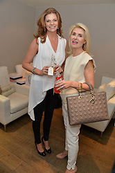 Left to right, FRANCESCA WATSON and DEBBIE GASS at a Valentine's charity event to raise heart awareness and support the charity Arrhythmia Alliance held at Sophie Gass, 4 Ladbroke Grove, London on 13th February 2014.