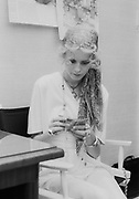 """1960's supermodel """"Twiggy"""" backstage before a fashion show in 1968. Dame Lesley Lawson DBE -  born 19 September 1949 - is an English model, actress, and singer, widely known by the nickname Twiggy. She was a British cultural icon and a prominent teenage model during the swinging sixties in London.<br /> <br /> Twiggy was initially known for her thin build (thus her nickname) and the androgynous appearance considered to result from her big eyes, long eyelashes, and short hair.She was named """"The Face of 1966"""" by the Daily Express and voted British Woman of the Year. By 1967, she had modeled in France, Japan, and the US, and had landed on the cover of Vogue. Her fame had spread worldwide.<br /> <br /> After modelling, Twiggy enjoyed a successful career as a screen, stage, and television actress. Her role in The Boy Friend (1971) brought her two Golden Globe Awards. In 1983 she made her Broadway debut in the musical My One and Only, for which she earned a Tony nomination for Best Actress in a Musical. She later hosted her own series, Twiggy's People, in which she interviewed celebrities; she also appeared as a judge on the reality show America's Next Top Model. Her 1998 autobiography Twiggy in Black and White entered the best-seller lists.[3] Since 2005, she has modelled for Marks and Spencer, most recently to promote their recent rebranding, appearing in television advertisements and print media, alongside Myleene Klass, Erin O'Connor, Lily Cole, and others.[5] In 2012, she worked alongside Marks & Spencer's designers to launch an exclusive clothing collection for the M&S Woman range.["""