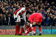 Jack Wilshere of Arsenal (c)  sits on the pitch injured. Carabao Cup , semi final 1st leg match, Chelsea v Arsenal at Stamford Bridge in London on Wednesday 10th January 2018.<br /> pic by Steffan Bowen, Andrew Orchard sports photography.
