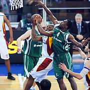Galatasaray's Jamon Lucas GORDON (L) and Unics Kazan's Terrell LYDAY (2ndR) during their Euroleague Game 2 basketball match Galatasaray between Unics Kazan at the Abdi Ipekci Arena in Istanbul at Turkey on Thursday, October, 27, 2011. Photo by TURKPIX
