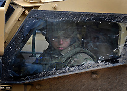 © Licensed to London News Pictures. 09/03/2012. Copedown Hill, UK. A soldier looks out of an armoured vehicle. Secretary of Defence Philip Hammond visits troops during the day. The 12thMechanized Brigade (12 Mech Bde) at Copehill Down, Salisbury Plain Training Area, Wiltshire,on FRIDAY 09 MARCH 2012, as it prepares to deploy to Helmand Province, Afghanistan, on Operation Herrick 16, in the Spring of this year. The Brigade were performing a dynamic demonstration of combined Afghan/ISAF operations supported by surveillance assets and casualty evacuation capability. Tornado GR4 fast jest ground support was also displayed.. Photo credit : Stephen SImpson/LNP