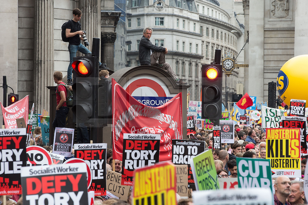 © Licensed to London News Pictures . 20/06/2015 . London , UK . Crowds outside the Bank of England . Tens of thousands of people march from the Bank of England to Parliament , to protest economic austerity in Britain . Photo credit: Joel Goodman/LNP