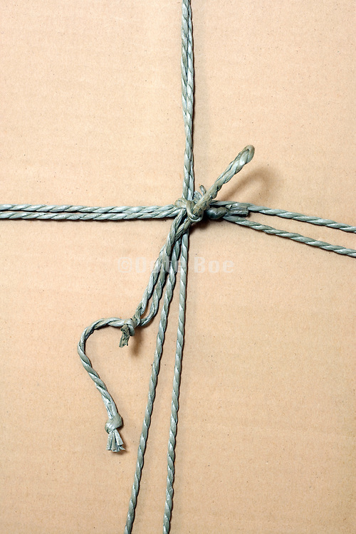 close up of the string of a wrapped up carton box