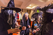 31 OCTOBER 2013 - PHOENIX, AZ:  Immigration activists dressed as Halloween witches conjure a spell against Arizona Governor Jan Brewer Thursday. About 20 supporters of the DREAM Act and the deferred action program of President Barack Obama visited the office of Arizona Governor Jan Brewer to protest her decision to deny drivers licenses to Arizona DREAMERS and immigrants granted deferred action status by immigration authorities. The protest was a part of ongoing series of actions by immigration rights activists in Arizona to protest against anti-immigrant actions taken by Arizona political leaders.    PHOTO BY JACK KURTZ