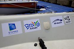 Race Boat Branding/Layout. Starboatrd side rear cockpit. Korea Match Cup 2010. World Match Racing Tour. Gyeonggi, Korea. 10th June 2010. Photo: Ian Roman/Subzero Images.