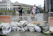 BEIJING, CHINA - JULY 20: <br /> <br /> Citizens walk in ponding toward subway station on July 20, 2016 in Tianjin, China. Tianjin Meteorological Observatory has issued an orange alert to heavy rainfall at 08:07 am early Wednesday and the rainstorm is predicted to continue in following six hours. <br /> ©Exclusivepix Media