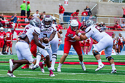 NORMAL, IL - October 02: Braydon Deming attempts to get past a blocker to get to Jason Shelley as he hands off to Kevon Latulas during a college football game between the Bears of Missouri State and the ISU (Illinois State University) Redbirds on October 02 2021 at Hancock Stadium in Normal, IL. (Photo by Alan Look)